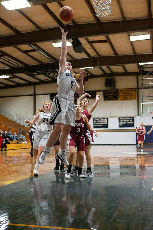 . Lisbeth Hoyt shoots a layup for St. Bernard\'s. SENTINEL & ENTERPRISE / GARY FOURNIER