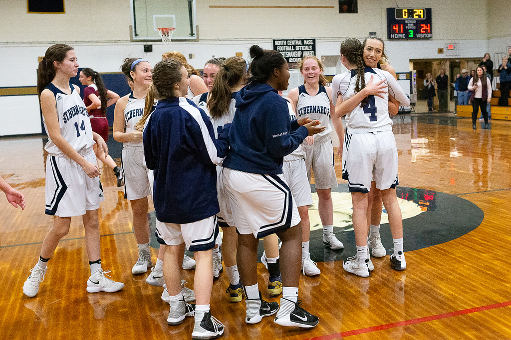 . St. Bernard\'s Sabrina Patton celebrates with her team after scoring her 1,000th career varsity point. SENTINEL & ENTERPRISE / GARY FOURNIER