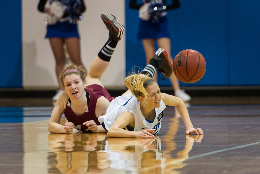 Danyelle Shufelt (15) and an opposing player go after a loose ball during the Women's Basketball game between Saint Joseph's (ME) and Anna Maria College at Saint Joseph's College, Standish, Maine, USA on January 19, 2013. Photo: Chris Poss