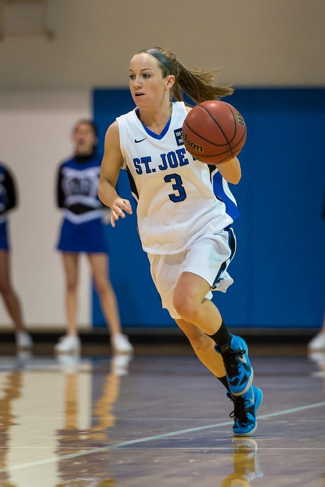 Mackenzie Dufour (3) during the Women's Basketball game between Saint Joseph's (ME) and Anna Maria College at Saint Joseph's College, Standish, Maine, USA on January 19, 2013. Photo: Chris Poss