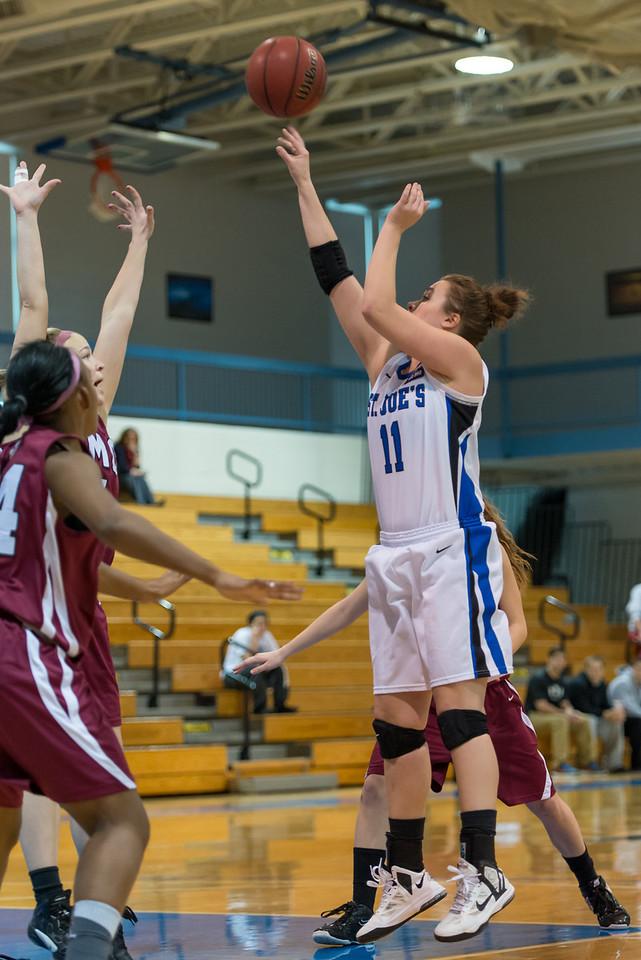 Alyssa Grigware (11) shoots during the Women's Basketball game between Saint Joseph's (ME) and Anna Maria College at Saint Joseph's College, Standish, Maine, USA on January 19, 2013. Photo: Chris Poss