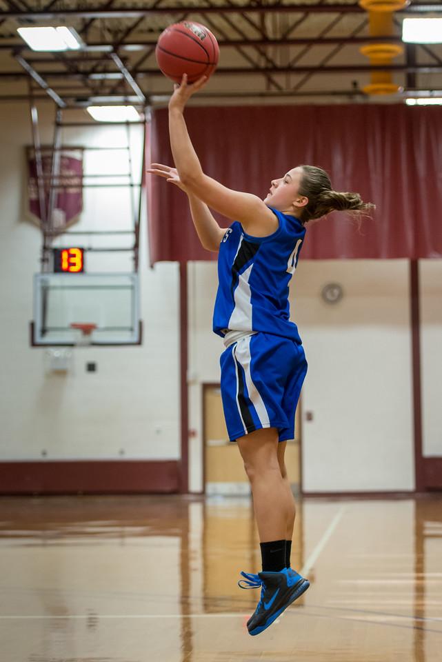 Skyler Makkinje (4) shoots during the Women's Basketball game between Saint Joseph's (ME) and Norwich University at Norwich University, Northfield, Vermont, USA on January 05, 2013. Photo: Chris Poss