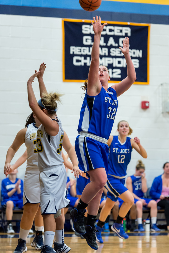 Morgan Cahill (32) shoots with Abby Young (12) in the background during the Women's Basketball game between Saint Joseph's (ME) and Saint Joseph's University (CT) at Saint Joseph's University, Hartford, Connecticut, USA on January 26, 2013. Photo: Chris Poss