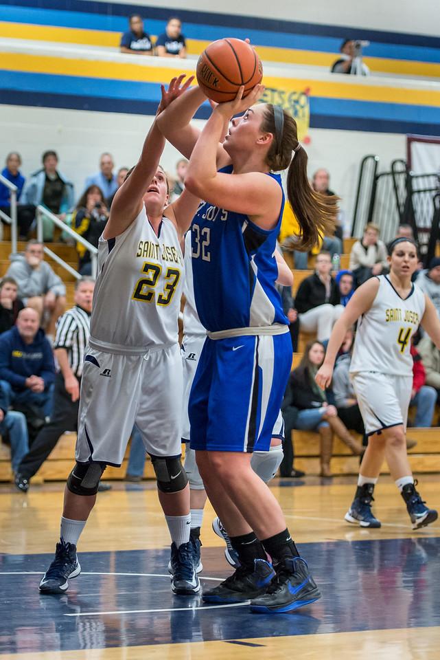 Morgan Cahill (32) shoots during the Women's Basketball game between Saint Joseph's (ME) and Saint Joseph's University (CT) at Saint Joseph's University, Hartford, Connecticut, USA on January 26, 2013. Photo: Chris Poss