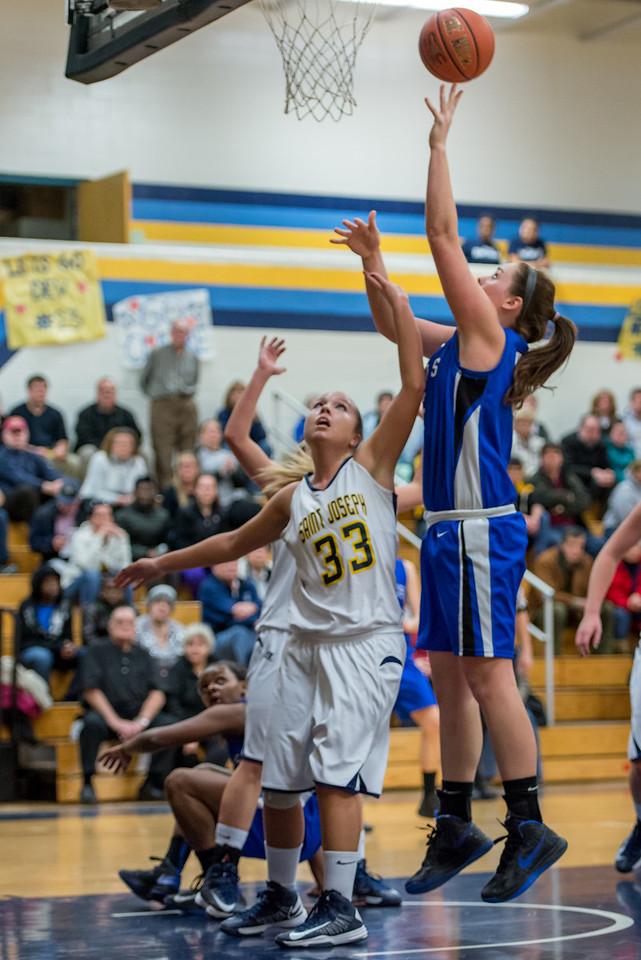 Morgan Cahill (32) shoots while Sarah Assante (20) looks on during the Women's Basketball game between Saint Joseph's (ME) and Saint Joseph's University (CT) at Saint Joseph's University, Hartford, Connecticut, USA on January 26, 2013. Photo: Chris Poss