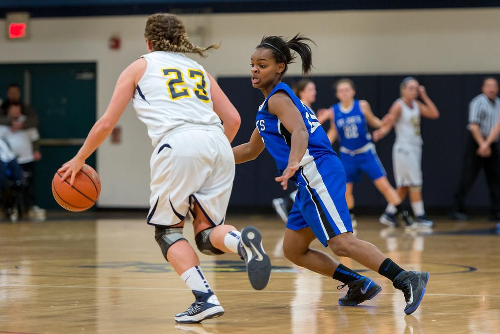 Sarah Assante (20) applying pressure on defense during the Women's Basketball game between Saint Joseph's (ME) and Saint Joseph's University (CT) at Saint Joseph's University, Hartford, Connecticut, USA on January 26, 2013. Photo: Chris Poss