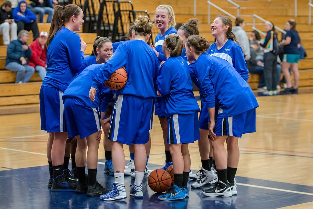 St. Joe's Team during the Women's Basketball game between Saint Joseph's (ME) and Saint Joseph's University (CT) at Saint Joseph's University, Hartford, Connecticut, USA on January 26, 2013. Photo: Chris Poss