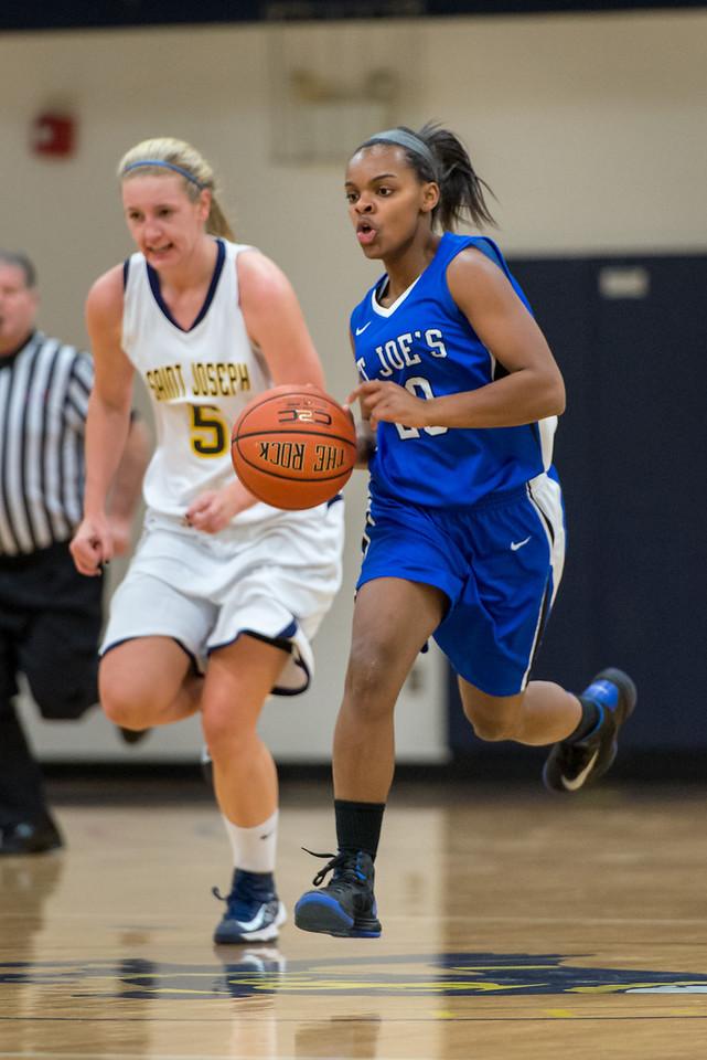 Sarah Assante (20) brings up the ball during the Women's Basketball game between Saint Joseph's (ME) and Saint Joseph's University (CT) at Saint Joseph's University, Hartford, Connecticut, USA on January 26, 2013. Photo: Chris Poss