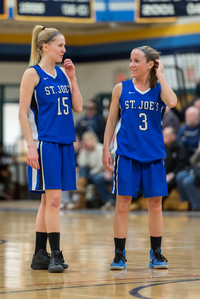 Danyelle Shufelt (15) and Mackenzie Dufour (3) during  a break in the action during the Women's Basketball game between Saint Joseph's (ME) and Saint Joseph's University (CT) at Saint Joseph's University, Hartford, Connecticut, USA on January 26, 2013. Photo: Chris Poss