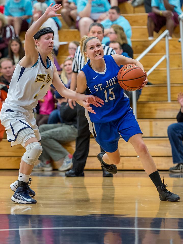Danyelle Shufelt (15) drives to the basket during the Women's Basketball game between Saint Joseph's (ME) and Saint Joseph's University (CT) at Saint Joseph's University, Hartford, Connecticut, USA on January 26, 2013. Photo: Chris Poss