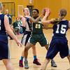 St. Leo's Faith Akoachere works around the defense during the game against Venerini in the CYO Basketball Tournament on Thursday evening. SENTINEL & ENTERPRISE / Ashley Green