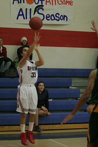 Strathmore Spartan Andrew Pearson (33) lets a 3-point shot fly against Sierra Pacific on January 17, 2013.