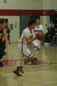 Leonard Massey (4) of Strathmore dribbles up court vs. Sierra Pacific on January 17, 2013.