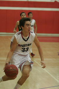 Strathmore Spartan Andrew Pearson (33) drives toward the basket against Sierra Pacific on 1-17-13.