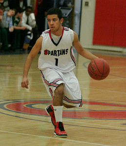 Strathmore's Eric Lopez (1) runs the Spartan offense against Sierra Pacific on January 17, 2013.