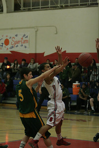 Strathmore Spartan Maurisio (3) drive the paint against Sierra Pacific's Francisco Gonzalez (5).
