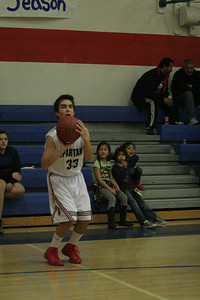 Strathmore Spartan Andrew Pearson (33) shoots from  behind the 3-point line against Sierra Pacific on January 17, 2013.