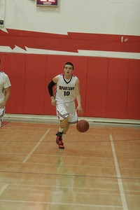 Orlando Maciel (10) dribbles the ball on a fastbreak against Sierra Pacific on January 17, 2013
