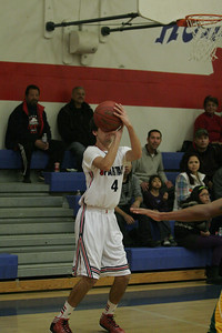 Strathmore Spartan Leonard Massey (4) takes a shot against Sierra Pacific on January 17, 2013.