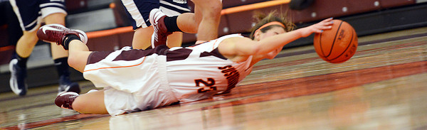 Susquehanna University's Catherine Malatack attempts to save the ball during the crusaders 75-44 win over Penn State Hazelton on Wednesday night in Selinsgrove.
