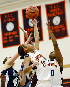 Susquehanna's Jonaida Williams and Candence Cannady fight for the rebound with a Penn State Hazelton player on Wednesday night in Selinsgrove.