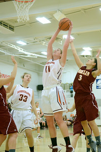Susquehanna's Jackie Clarke goes up to grab a rebound over Oberlin's Lindsey Bernhardt during Sunday's game.