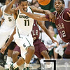 Nov 20, 2011; East Lansing, MI, USA; Michigan State Spartans guard Keith Appling (11) and Arkansas Little Rock Trojans forward Courtney Jackson (12) battle for the ball during the first half at the Breslin Center. Mandatory Credit: Tim Fuller-US PRESSWIRE