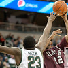 Nov 20, 2011; East Lansing, MI, USA; Arkansas Little Rock Trojans forward Courtney Jackson (12) shoots over Michigan State Spartans forward Draymond Green (23) during the second half at the Breslin Center. The Spartans won 69-47. Mandatory Credit: Tim Fuller-US PRESSWIRE