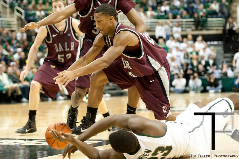 Nov 20, 2011; East Lansing, MI, USA; Arkansas Little Rock Trojans guard Ben Dillard (24) and Michigan State Spartans forward Draymond Green (23) go for a loose ball during the second half at the Breslin Center. The Spartans won 69-47. Mandatory Credit: Tim Fuller-US PRESSWIRE