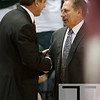 Nov 20, 2011; East Lansing, MI, USA; Michigan State Spartans head coach Tom Izzo (right) greets Arkansas Little Rock Trojans head coach Steve Shields (left) before the game at the Breslin Center. Mandatory Credit: Tim Fuller-US PRESSWIRE
