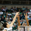 Nov 20, 2011; East Lansing, MI, USA; Arkansas Little Rock Trojans guard D'Andre Williams (10) shoots over Michigan State Spartans guard Travis Trice (20) during the first half at the Breslin Center. The Spartans won 69-47. Mandatory Credit: Tim Fuller-US PRESSWIRE