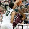 Nov 20, 2011; East Lansing, MI, USA; Michigan State Spartans guard Travis Trice (20) blocks Arkansas Little Rock Trojans guard D'Andre Williams (10) during the first half at the Breslin Center. Mandatory Credit: Tim Fuller-US PRESSWIRE