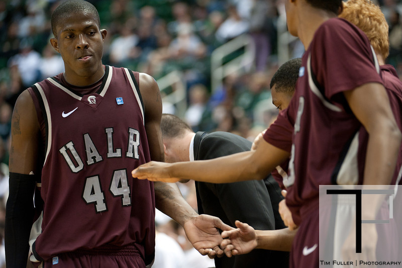 Nov 20, 2011; East Lansing, MI, USA; Arkansas Little Rock Trojans forward Michael Javes (44) high-fives teammates during the second half against the Michigan State Spartans at the Breslin Center. The Spartans won 69-47. Mandatory Credit: Tim Fuller-US PRESSWIRE