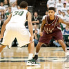 Nov 20, 2011; East Lansing, MI, USA; Arkansas Little Rock Trojans guard Chuck Guy (13) looks to get past Michigan State Spartans guard Brandon Wood (30) during the second half at the Breslin Center. The Spartans won 69-47. Mandatory Credit: Tim Fuller-US PRESSWIRE