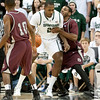 Nov 20, 2011; East Lansing, MI, USA; Michigan State Spartans center Derrick Nix (25) backs down Arkansas Little Rock Trojans forward Courtney Jackson (12) during the first half at the Breslin Center. Mandatory Credit: Tim Fuller-US PRESSWIRE