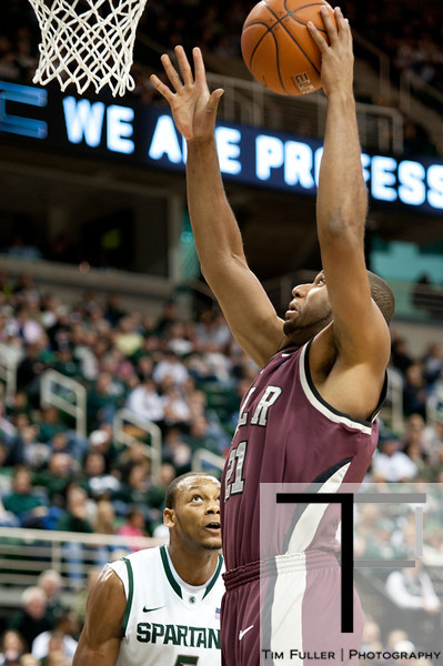 Nov 20, 2011; East Lansing, MI, USA; Arkansas Little Rock Trojans forward Marlon Louzeiro (21) makes a basket during the second half against the Michigan State Spartans at the Breslin Center. The Spartans won 69-47. Mandatory Credit: Tim Fuller-US PRESSWIRE
