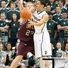 Nov 20, 2011; East Lansing, MI, USA; Arkansas Little Rock Trojans forward Taggart Lockhart (23) guards Michigan State Spartans guard Travis Trice (20)  during the first half at the Breslin Center. Mandatory Credit: Tim Fuller-US PRESSWIRE