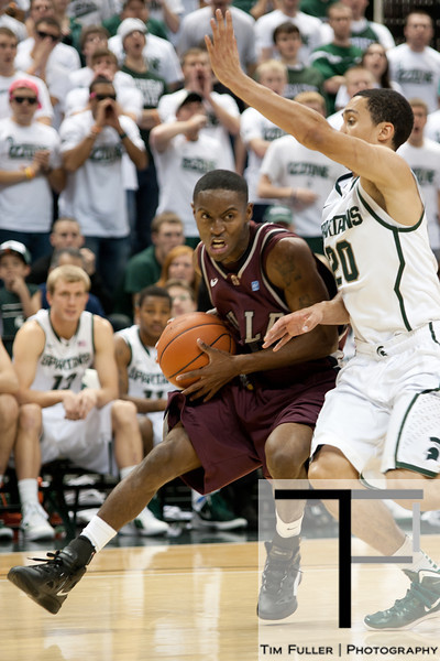 Nov 20, 2011; East Lansing, MI, USA; Arkansas Little Rock Trojans guard D'Andre Williams (10) attempts to get past Michigan State Spartans guard Travis Trice (20) during the first half at the Breslin Center. Mandatory Credit: Tim Fuller-US PRESSWIRE