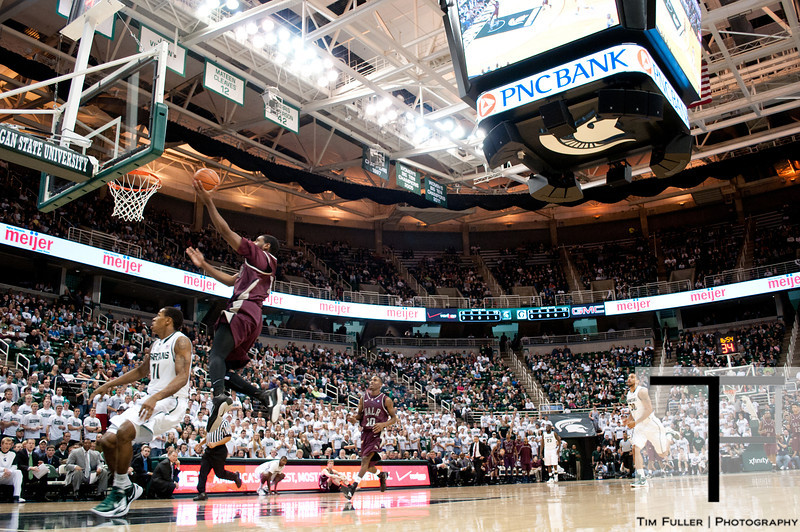 Nov 20, 2011; East Lansing, MI, USA; Arkansas Little Rock Trojans guard D'Andre Williams (10) makes a lay up against the Michigan State Spartans during the first half at the Breslin Center. The Spartans won 69-47. Mandatory Credit: Tim Fuller-US PRESSWIRE