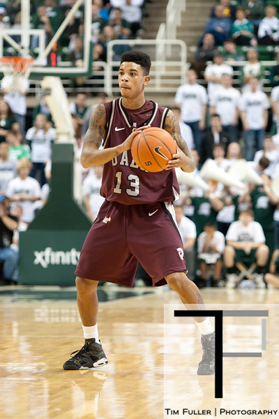 Nov 20, 2011; East Lansing, MI, USA; Arkansas Little Rock Trojans guard Chuck Guy (13) looks to pass against the Michigan State Spartans during the second half at the Breslin Center. The Spartans won 69-47. Mandatory Credit: Tim Fuller-US PRESSWIRE