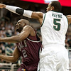 Nov 20, 2011; East Lansing, MI, USA; Arkansas Little Rock Trojans guard Tramar Sutherland (2) gets past Michigan State Spartans center Adreian Payne (5) during the second half at the Breslin Center. The Spartans won 69-47. Mandatory Credit: Tim Fuller-US PRESSWIRE