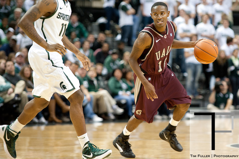 Nov 20, 2011; East Lansing, MI, USA; Arkansas Little Rock Trojans guard D'Andre Williams (10) looks to get past the Michigan State Spartans defense during the second half at the Breslin Center. The Spartans won 69-47. Mandatory Credit: Tim Fuller-US PRESSWIRE
