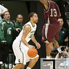 Nov 20, 2011; East Lansing, MI, USA; Arkansas Little Rock Trojans guard Chuck Guy (13) attempts to block Michigan State Spartans guard Brandon Wood (30) during the first half at the Breslin Center. Mandatory Credit: Tim Fuller-US PRESSWIRE