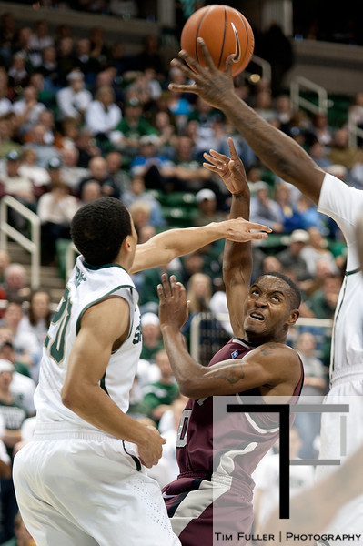 Nov 20, 2011; East Lansing, MI, USA; Arkansas Little Rock Trojans guard D'Andre Williams (10) makes a pass over Michigan State Spartans guard Travis Trice (20) during the first half at the Breslin Center. Mandatory Credit: Tim Fuller-US PRESSWIRE