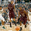 Nov 20, 2011; East Lansing, MI, USA; Michigan State Spartans guard Keith Appling (11) and Arkansas Little Rock Trojans guards Eric Lawton (5) and D'Andre Williams (10) go after a loose ball during the first half at the Breslin Center. Mandatory Credit: Tim Fuller-US PRESSWIRE