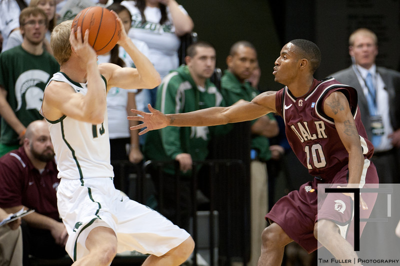 Nov 20, 2011; East Lansing, MI, USA; Arkansas Little Rock Trojans guard D'Andre Williams (10) guards Michigan State Spartans guard Austin Thornton (13) during the first half at the Breslin Center. Mandatory Credit: Tim Fuller-US PRESSWIRE