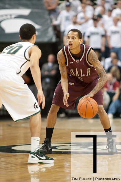 Nov 20, 2011; East Lansing, MI, USA; Arkansas Little Rock Trojans guard Eric Lawton (5) is guarded by Michigan State Spartans guard Travis Trice (20) during the first half at the Breslin Center. Mandatory Credit: Tim Fuller-US PRESSWIRE
