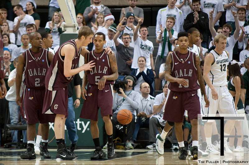 Nov 20, 2011; East Lansing, MI, USA; Arkansas Little Rock Trojans guards Tramar Sutherland (2) and Chuck Guy (13), as forward Will Neighbour (53)talks to guard Eric Lawton (5) during the second half against the Michigan State Spartans at the Breslin Center. The Spartans won 69-47. Mandatory Credit: Tim Fuller-US PRESSWIRE