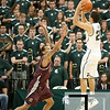 Nov 20, 2011; East Lansing, MI, USA; Michigan State Spartans guard Travis Trice (20) shoots over Arkansas Little Rock Trojans guard Eric Lawton (5)during the first half at the Breslin Center. Mandatory Credit: Tim Fuller-US PRESSWIRE