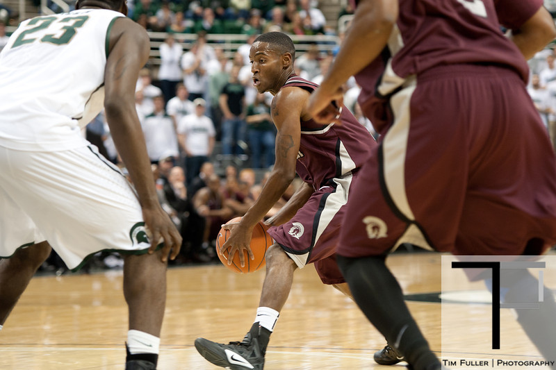 Nov 20, 2011; East Lansing, MI, USA; Arkansas Little Rock Trojans guard D'Andre Williams (center) looks to pass against the Michigan State Spartans  during the first half at the Breslin Center. Mandatory Credit: Tim Fuller-US PRESSWIRE